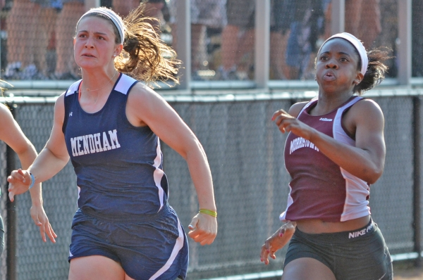 Morristown's Camille Carter, right, won the 100 meters at the Morris County Championships.