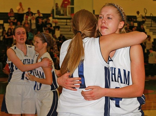 Teammates Kendall Davies and Amanda Berntsen hug at the end of the Group III semifinal.