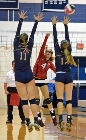 Mount Olive's Britney Rivera, No. 4, attempts a kill while Roxbury's Rachel Roberts and Kendall Torpin block.