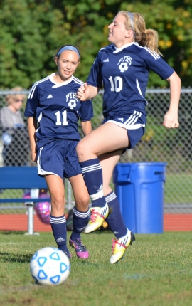 Katie DeLellis, No. 10, dribbles the ball during warmups while Carly Klimek looks on.