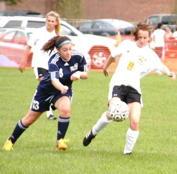 Hanover Park's Erin Rehm and Pequannock's Emily Wall battle for the ball.