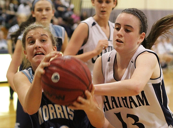 Morris Catholic's Alexa Giuliano and Sam Kennedy of Chatham fight for a rebound in MCT semifinal action.