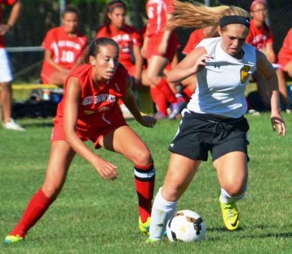 Hanover Park's Taylor Bermingham, right, controls the ball as a Parsippany player moves in.