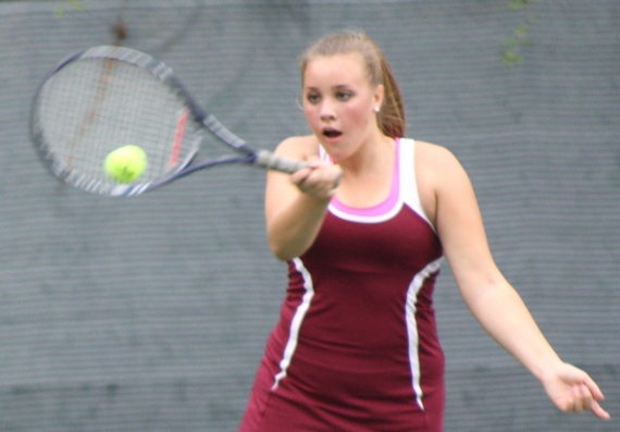 Melanie Greene, Madison's second singles player, returns a shot.