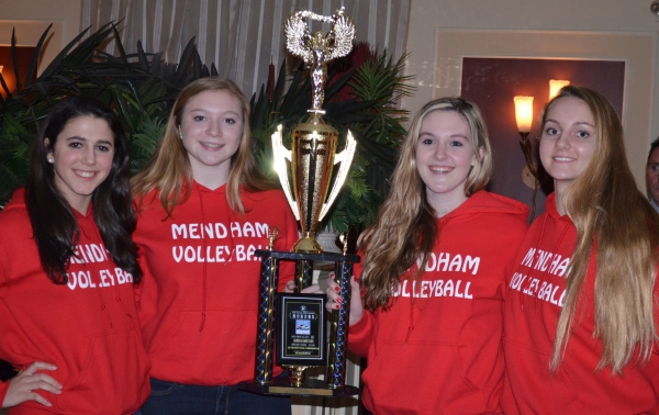 Mendham volleyball players pose with their trophy.