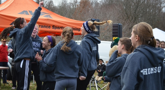 Above, Randolph runners rush to get their trophy at the awards ceremony.