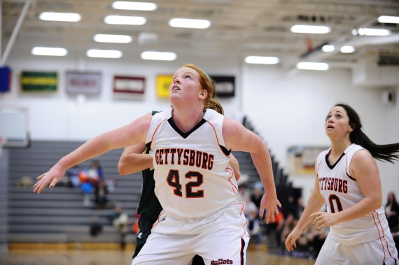 Caroline Murphy of Chatham, left, and Cori Younghans of Succasunna, right, have performed well for Gettysburg College this season. Below, Younghans races upcourt.