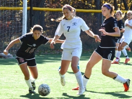 Randolph's Katja Brockelmanns-Puig, No. 7, moves the ball upfield.