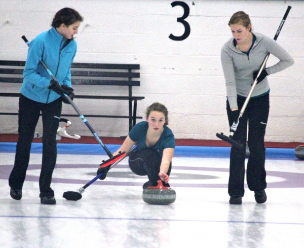 Katie Sullivan, center, participates in curling on a high level.
