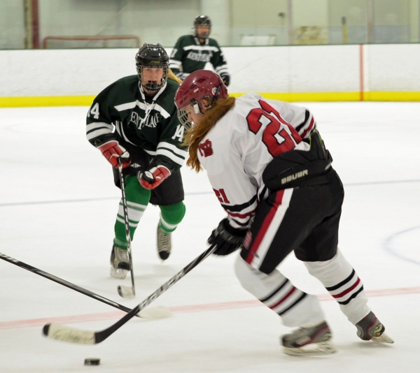 Morristown-Beard's Kathleen McNamara skates with the puck as Kent Place's Kathryn Giroux moves in.
