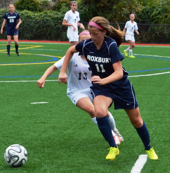 Roxbury's Paige Monahan, No. 11, races to the ball with a defender.