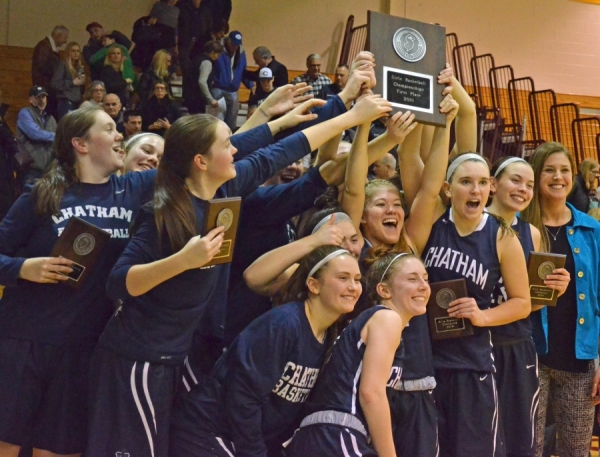 The joyous Chatham players pose for photos with their MCT championship plaque.