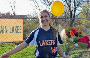 Jessica Torch poses with balloons and flowers after getting her 100th hit in late April.