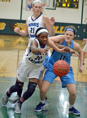 Feyi Idera of Morris Catholic, left, and West Morris' Caroline Coleman vie for the ball in a MCT quarterfinal.