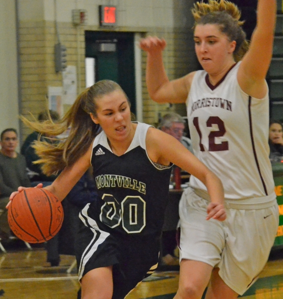 Montville's Jane Beiermeister, left, drives past Morristown's Abby Schubiger in a MCT quarterfinal.