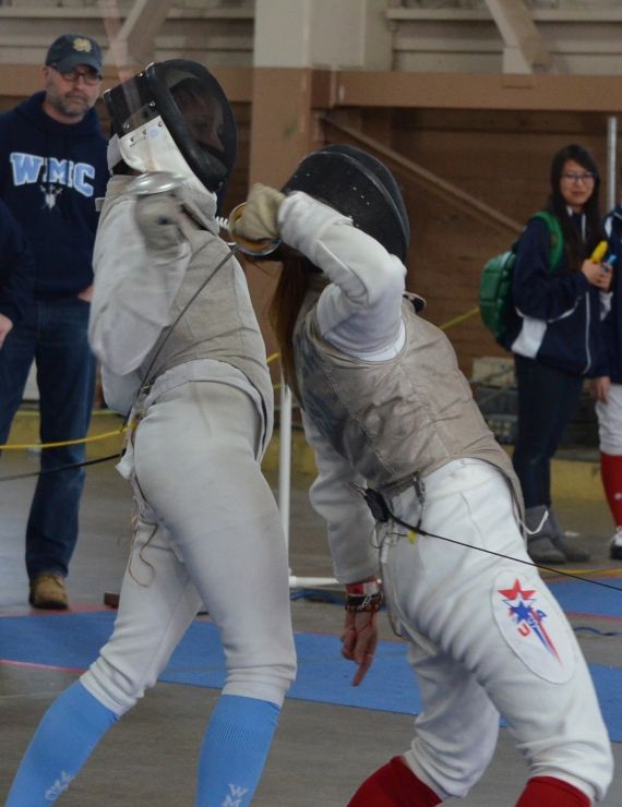 Sarah Zimmerman of Mendham, pictured in slideshow, fences in her last bout in the opening round.