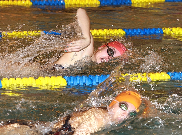 Taryn McLaughlin of Chatham and Rachel Emodi of Morristown are neck and neck in the 200-meter freestyle.