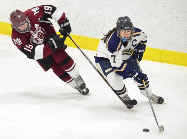 Morristown-Beard's Keegan Heher vies for the puck with Rye Country Day School's Olivia Weaver.