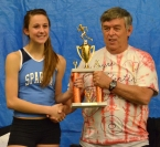 Claudia DiSomma of Sparta accepts a trophy from Wayne Valentine. DiSomma won the featured race, the one-mile run, at the Wayne Valentine Invitational.