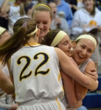 Pequannock players embrace Carly Klimek after she scored her 1,000th point.