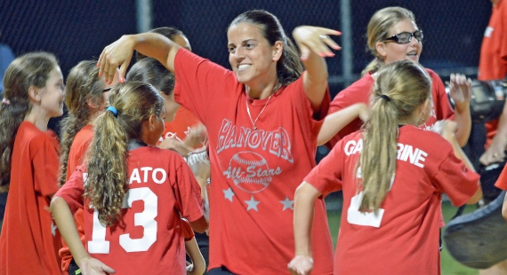 Coach Maria Mess, above, makes her way through the dancing Hanover 9/10 Little League Softball Team after their scrimmage on Tuesday, July 28. Below, the players enjoy pizza after practice with manager Kristin Yacat the night before departing for the state tournament.