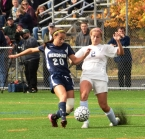 Mendham's No. 20, Julia Calabrese, and Randolph's No. 2, Anna Conklin, fight for the ball.