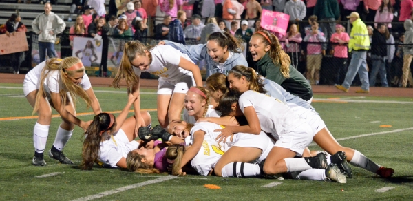 Morris Knolls players are joyful after their victory over Mendham in the MCT final.