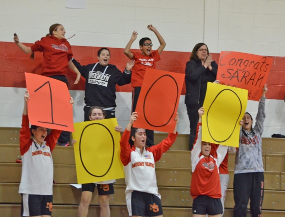 Mount Olive players and fans cheer Sarah McAvoy's achievement.