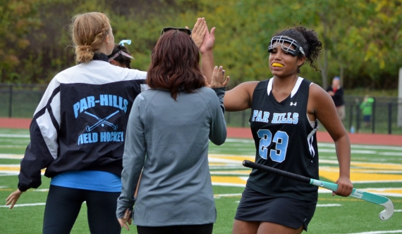 Isabel Sanchez is congratulated by the Par Hills coaches after the Vikings' upset win over Morris Knolls on Wednesday, Sept. 30.