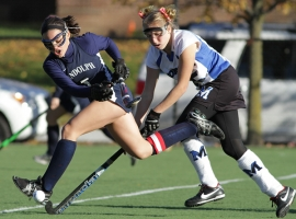 Randolph's Amanda Magadan tries to drive the ball with Montclair's Emily Mernin in pursuit.
