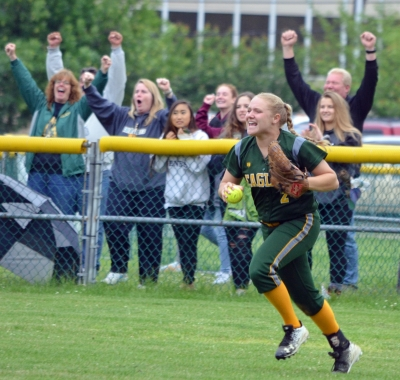 Right fielder Jess Heitmann races in to join her Morris Knolls teammates in celebrating after making the final out in the North Jersey Section 1, Group IV final.