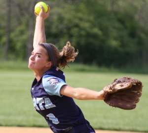 Gretchen Bowie, above, pitched the last seven innings for Sparta, striking out 13 and walking three. In the slideshow photo, Sparta assistant coach Virginia Buechel and Colleen Burdsall celebrate Burdsall's winning hit in the ninth inning.