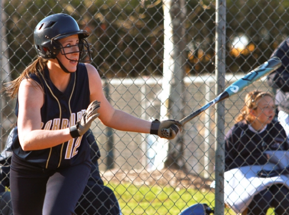 Roxbury's Holly Arentowicz heads to first after hitting a triple to center field to break a 3-3 tie in the top of the seventh inning.