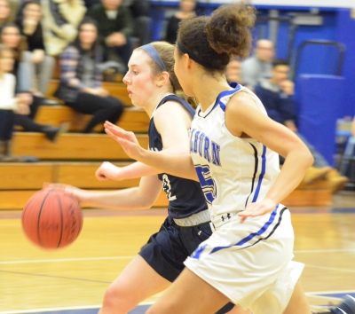 Chatham's Michaela Ford, in blue, races upcourt as Layla Stansberry of Millburn closes in.