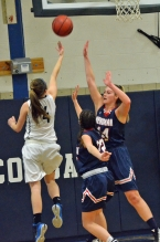 Chatham's Chloe Blanc, No. 4 on left, goes in for a layup in a state game against Mendham.