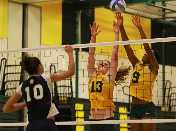 Shannon Hughes and Andrea Bush from Morris Knolls go up for a block against West Orange's Chavi St. Hill.