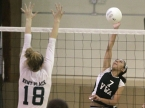 Villa Walsh's Anique Barch spikes the ball as Kent Place's Claire Crispo goes airborne to defend.