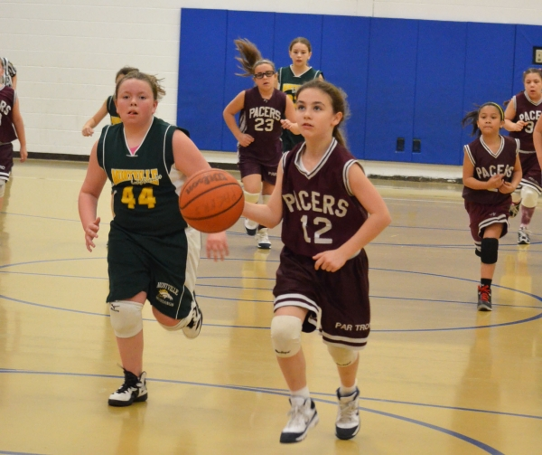 Natalie Braga of the Par-Troy Pacers Pee Wee Team brings the ball upcourt.