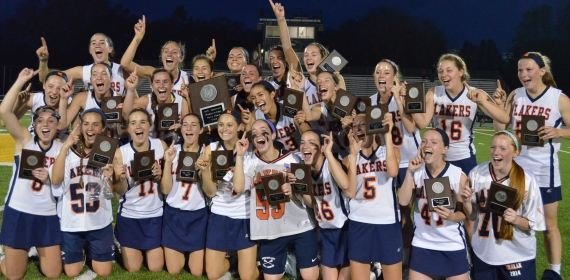 Mountain Lakes celebrates after repeating as MCT lacrosse champion.