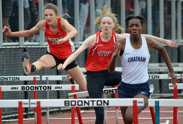 Whippany Park's Kristen Hall, center, was third in hurdles.