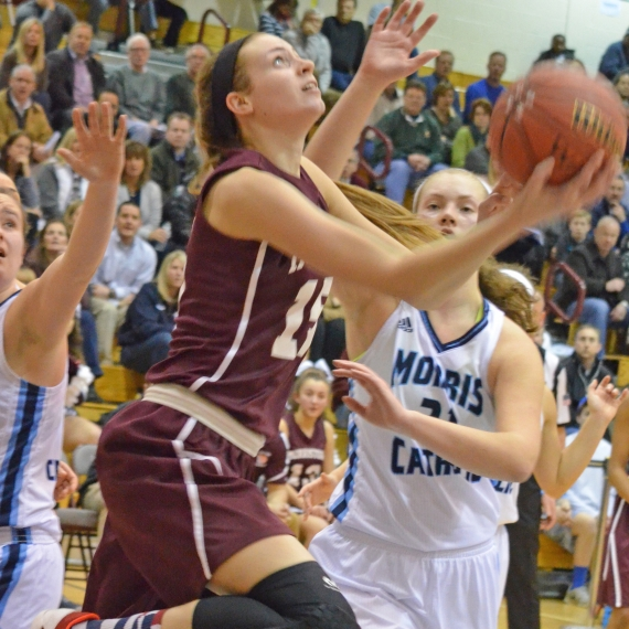 Morristown's Kayla Bush, above, drives to the basket while the Crusaders' Emma Duerr guards. In the slideshow, four of the Crusaders' starters count down the final few seconds on the sideline before celebrating their fourth consecutive MCT title.