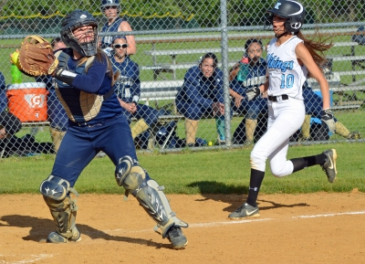 Roxbury catcher Hailey Womer steps on the plate to force out Parsippany Hills runner Izzy Mansur.