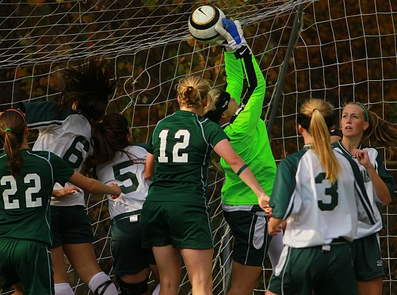 The fight for the ball ensues in front of the net as the winning goal is scored by Kinnelon's Karyn Anselmo.