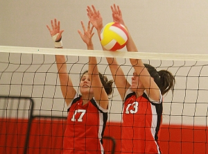 Jessica McEntee and Alanna Hutchinson-Lundy go up for a block against Parsippany.