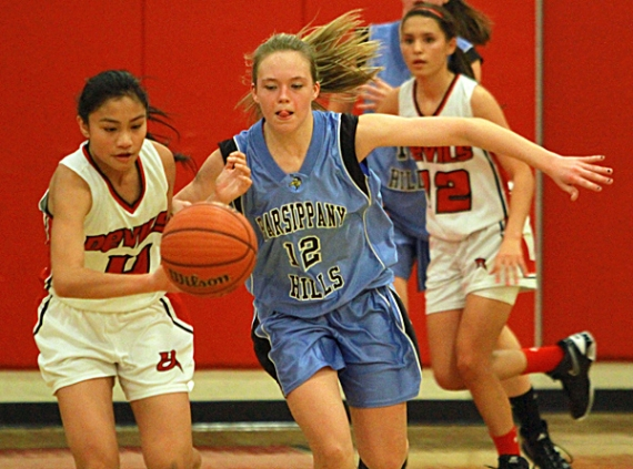 RebieAnne Reyes of Morris Tech and Parsippany Hills' Melanie Jablonka chase down the ball.