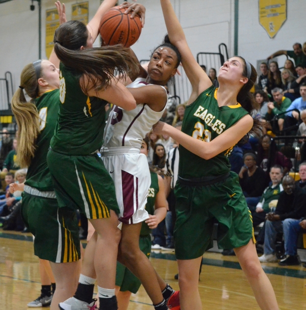 Kimberley Calloway, in white and maroon jersey, battles for a rebound with Morris Knolls' Krista Mitarotonda, left, and Becca Fair.