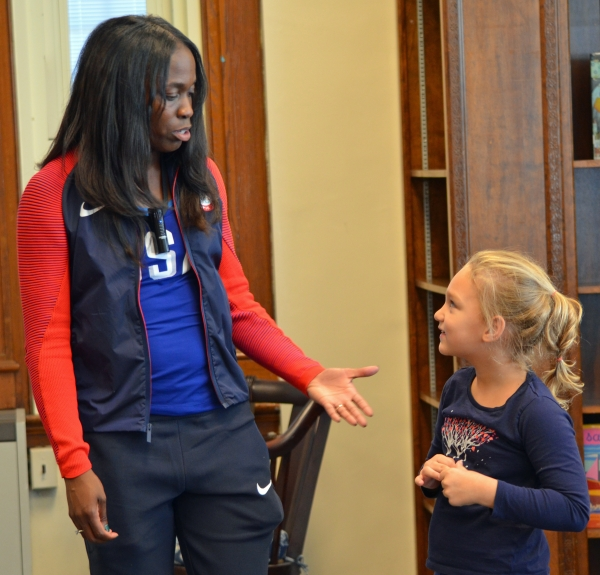 Catalina Herrera, right, a third grader at the Alexander Hamilton School in Morristown chats with Olympian Christina Epps.