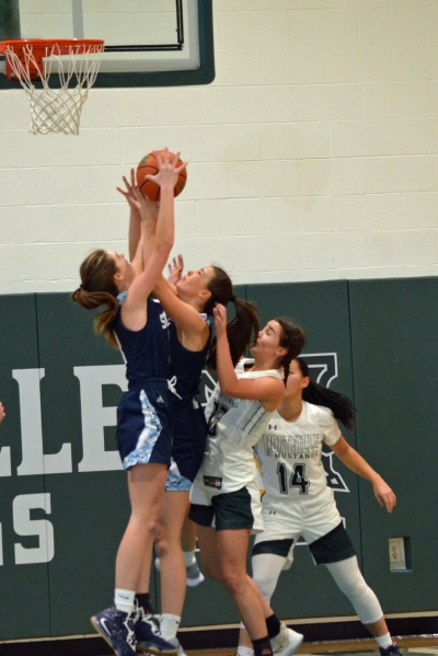 Sparta players battle to secure control of a rebound in a game against Montville on Thursday, Jan. 28, 2021.