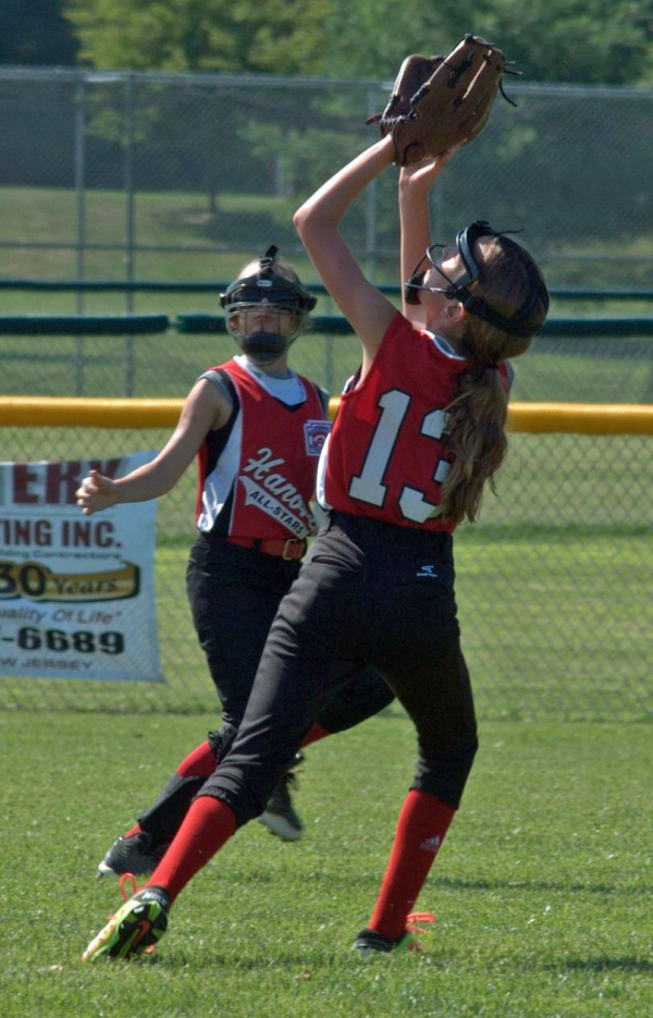 Defense was the Hanover 9/10s forte. Evelyn Dente, right, prepares to make a catch in center field.