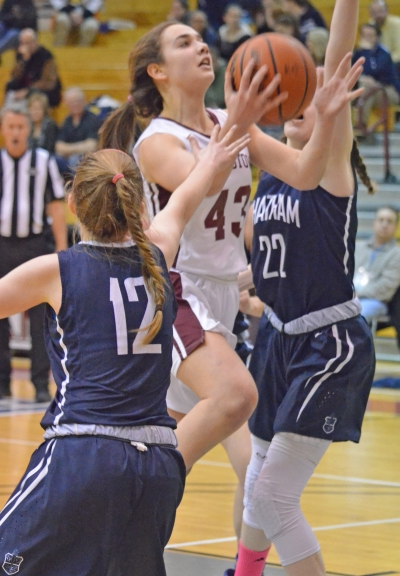 Morristown's Elizabeth Strambi goes up for a layup between Chatham's Michaela Ford and Veronica Kelly.